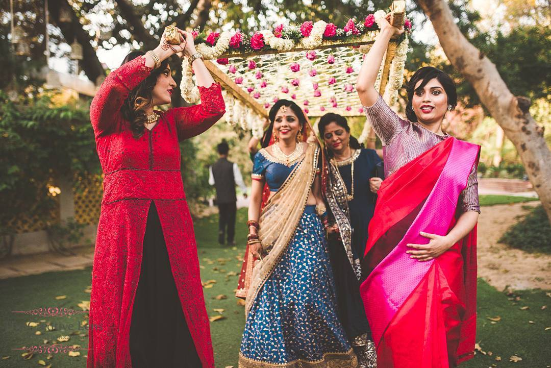 Bridal party entrance idea - with your bridesmaids holding the phoolon ki chadar instead of men