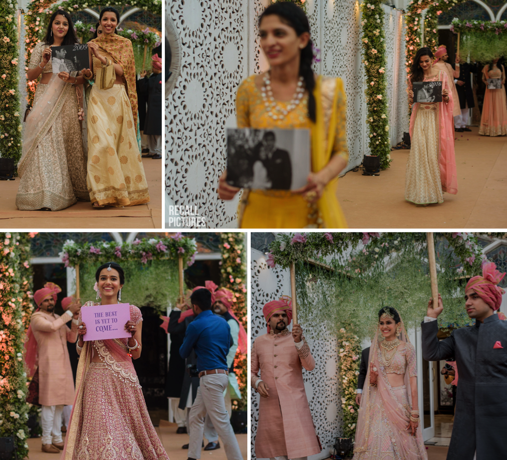 "Best bride entry seen at Indian wedding - bride's sisters and friends walk out with black and white photos of the bride and groom, bride's sister with a sign ""The Best is Yet to Come"" and then the bride under a baby's breath beautiful phoolon ki chadar"