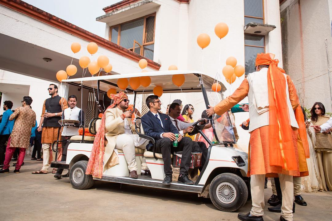 Awesome groom entry ideas - on a golf cart with balloons