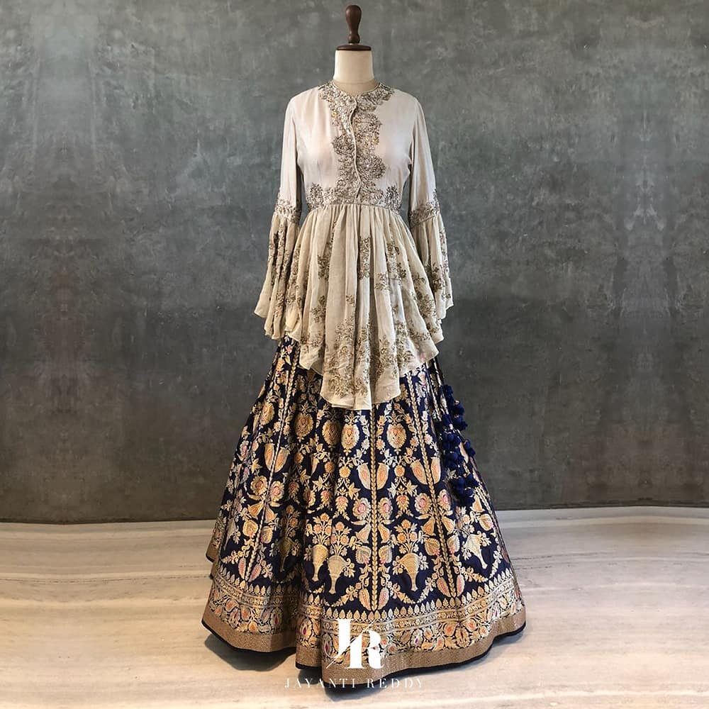 caf48fa8d99c7 Two fabric peplum blouse with flounce sleeves and benarsi silk lehenga in  blue and gold by