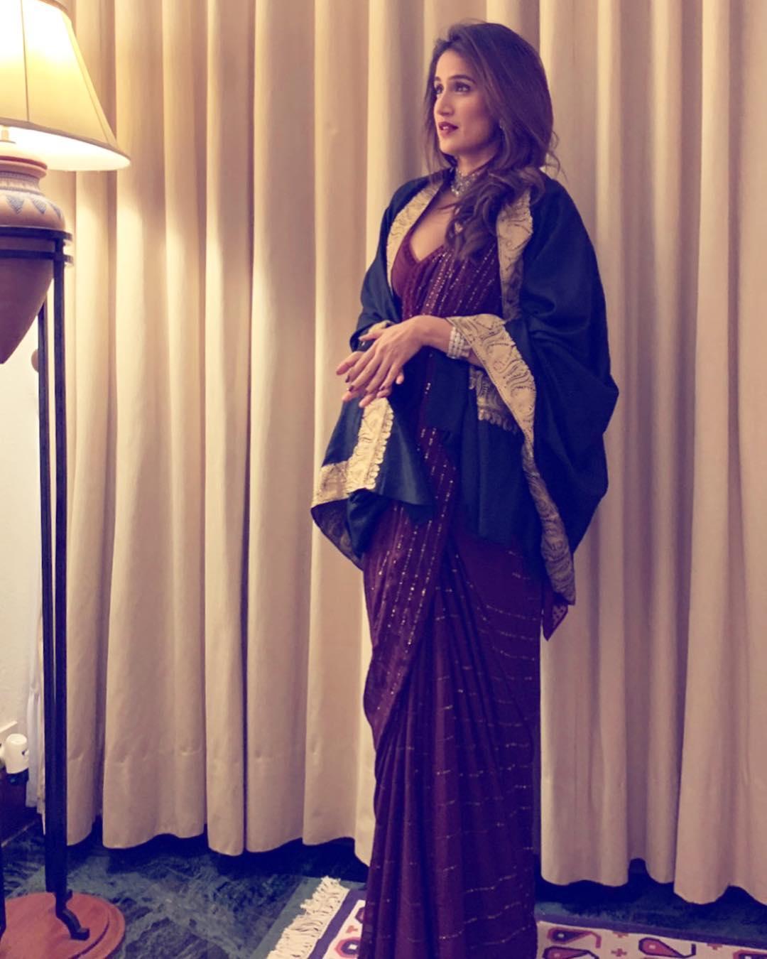 Actress Sagarika Ghatge in black shawl with maroon sari for a wedding