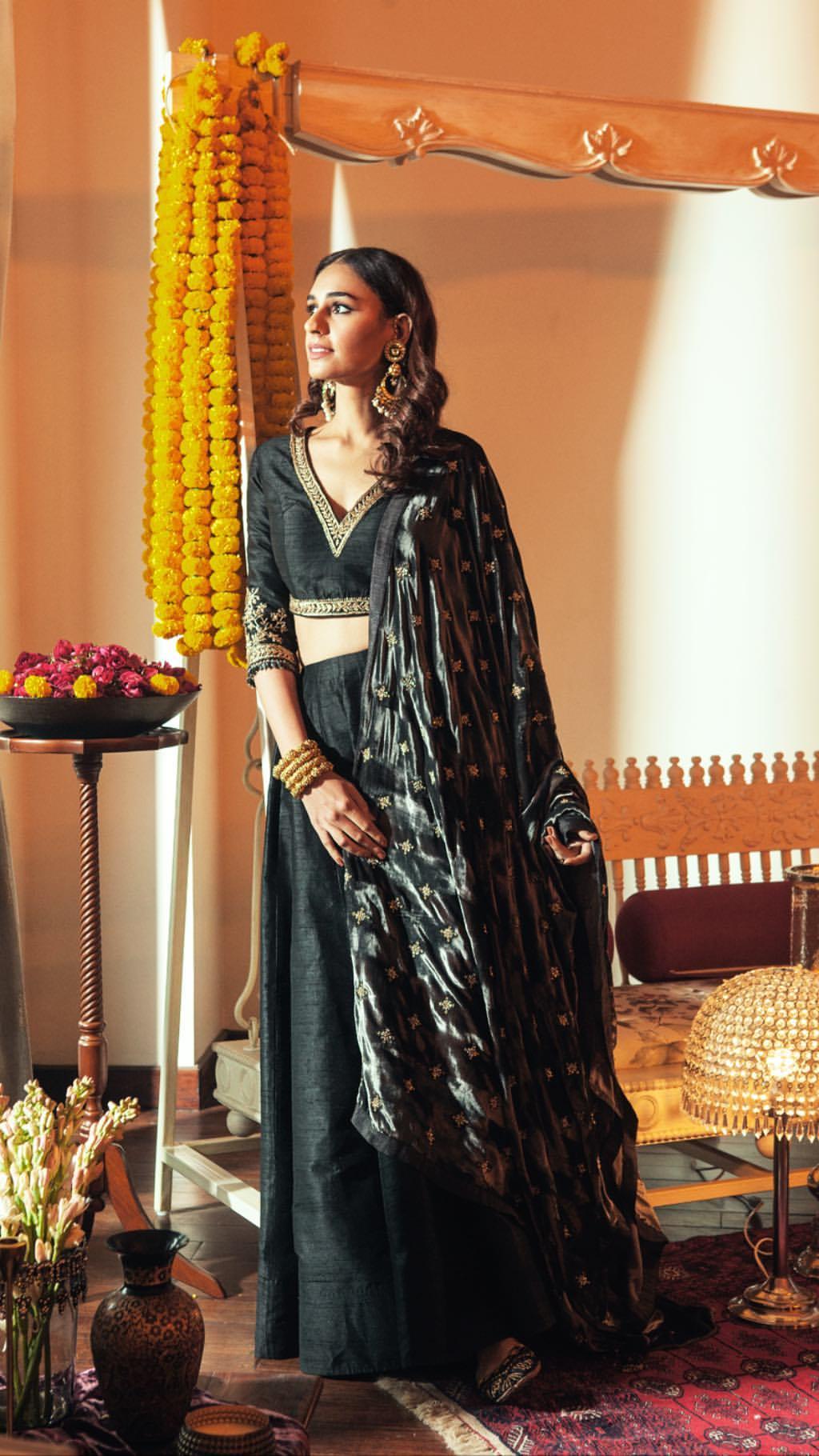 Black lehenga in raw silk with velvet dupatta by designer Sureena Chowdhri GK1 M Block market - Indian wedding outfits for winter