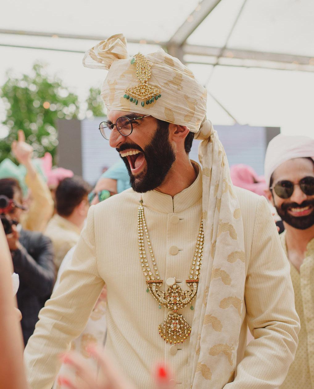 Peacock print white and gold wedding safa for groom
