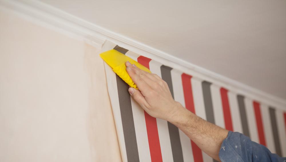 wallpapering painted walls