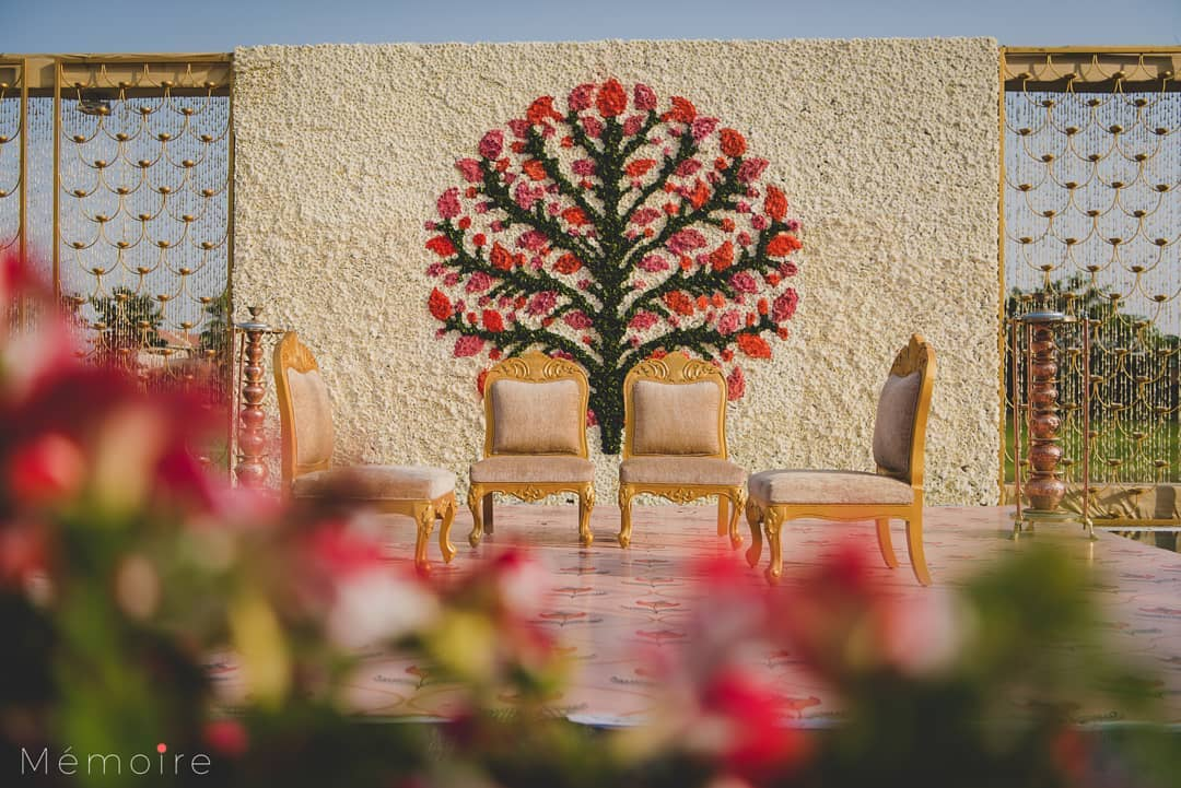 new simple wedding mandap with floral wall backdrop